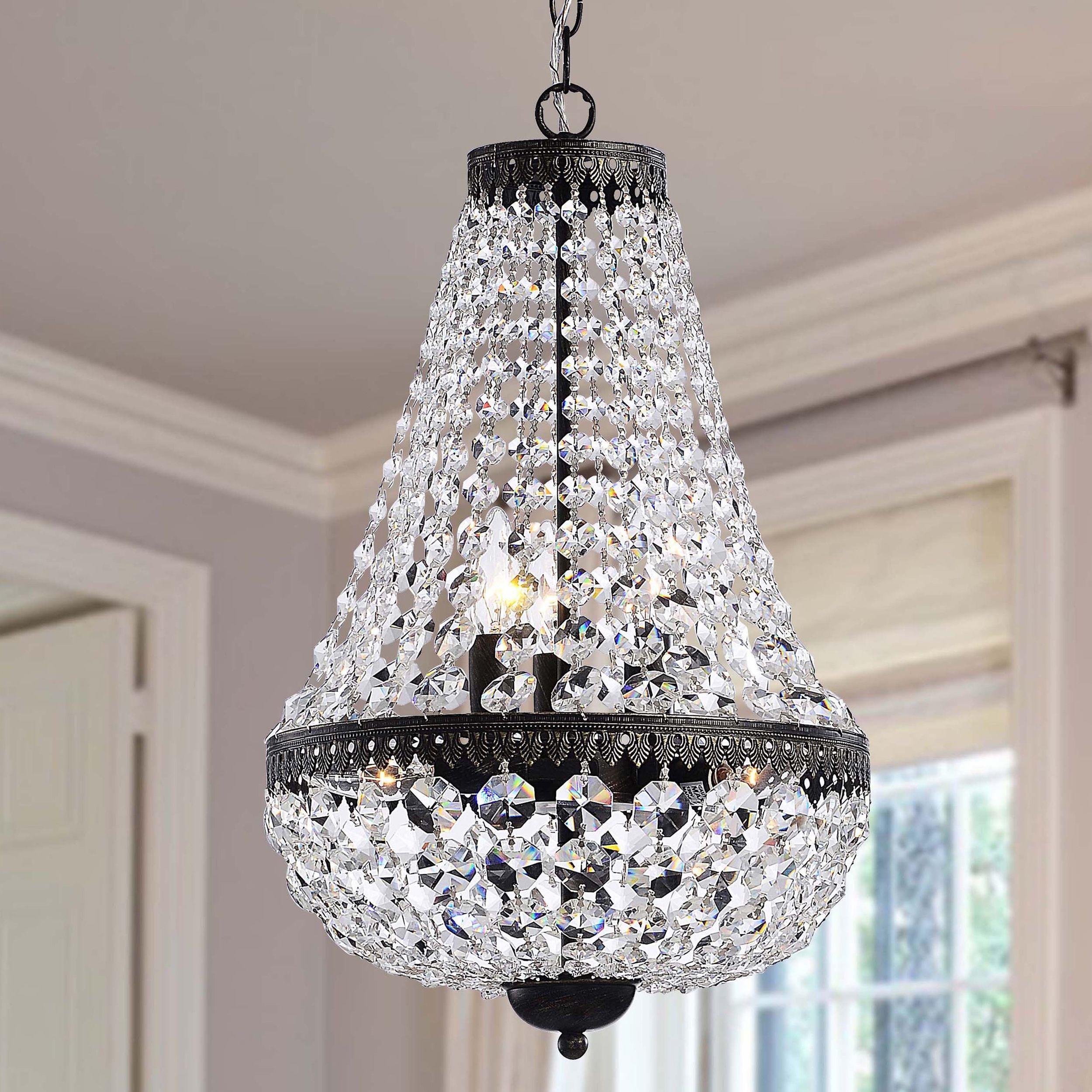 This Symmetric antique crystal chandelier features an antique