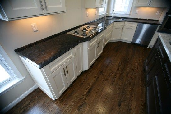 Best White Cabinets Black Counter Top Dark Wood Floor Tree 400 x 300
