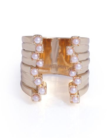 Pearls have been spotted all over the runway lately and this Pearl Lure Ring combines a feminine touch with a modern design. Super Chic!!!