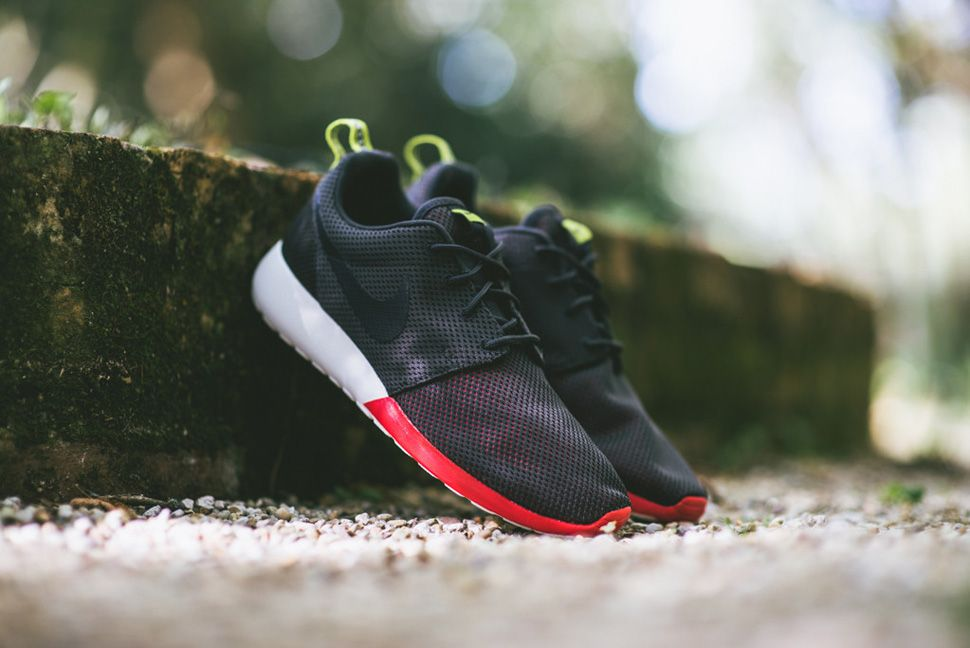 6996e3b26ab0a The latest Nike Roshe Run to drop featuring a full Anthracite base with  Venom Green and Red accents sitting atop Summit White sole.