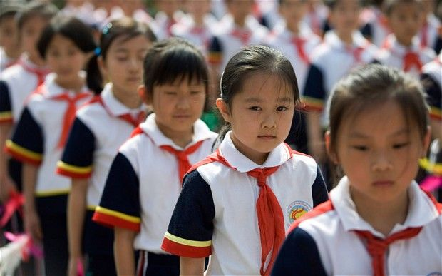 26,400 Chinese school children in toxic uniform scare | Asian