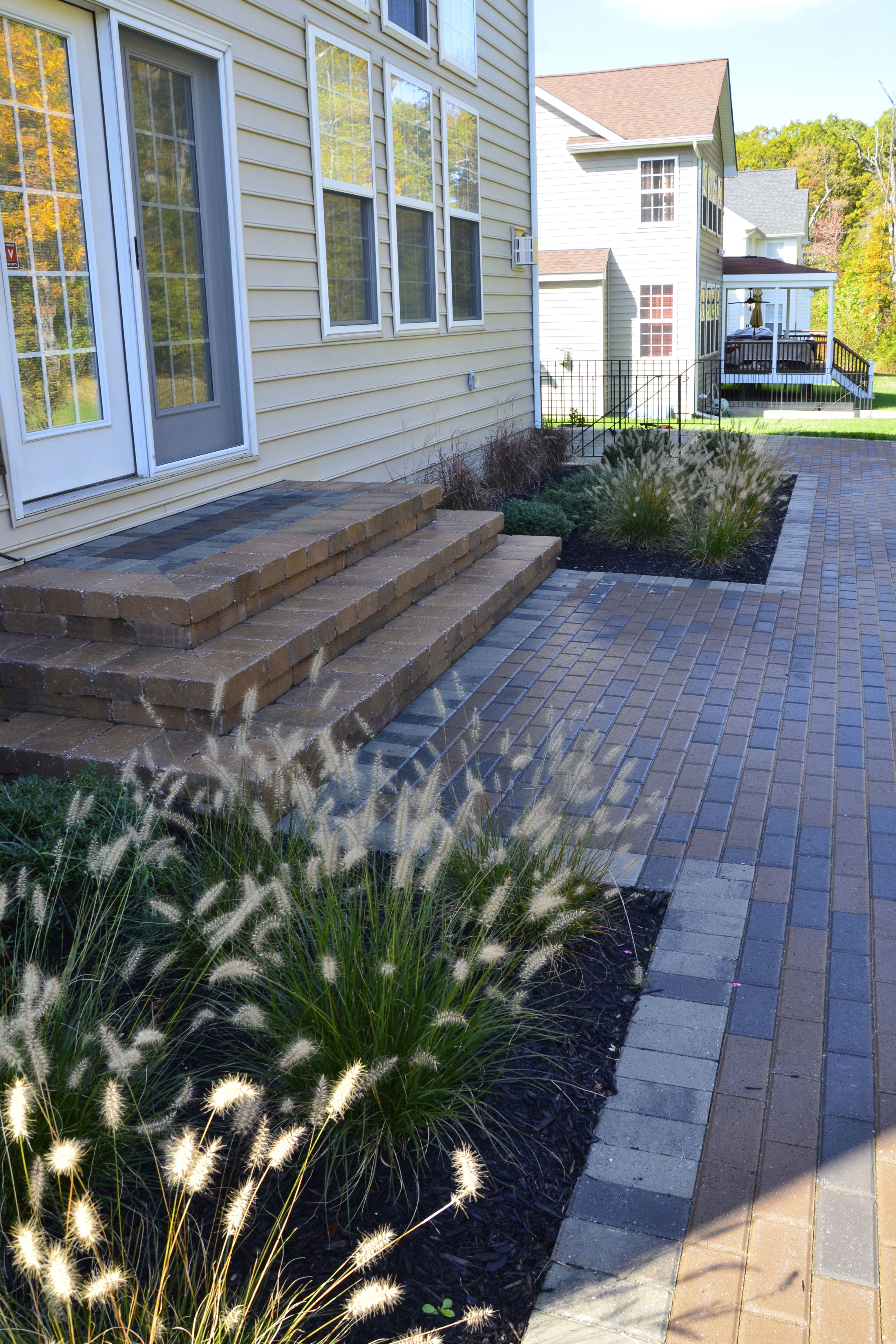 White Plains MD steps into house from patio