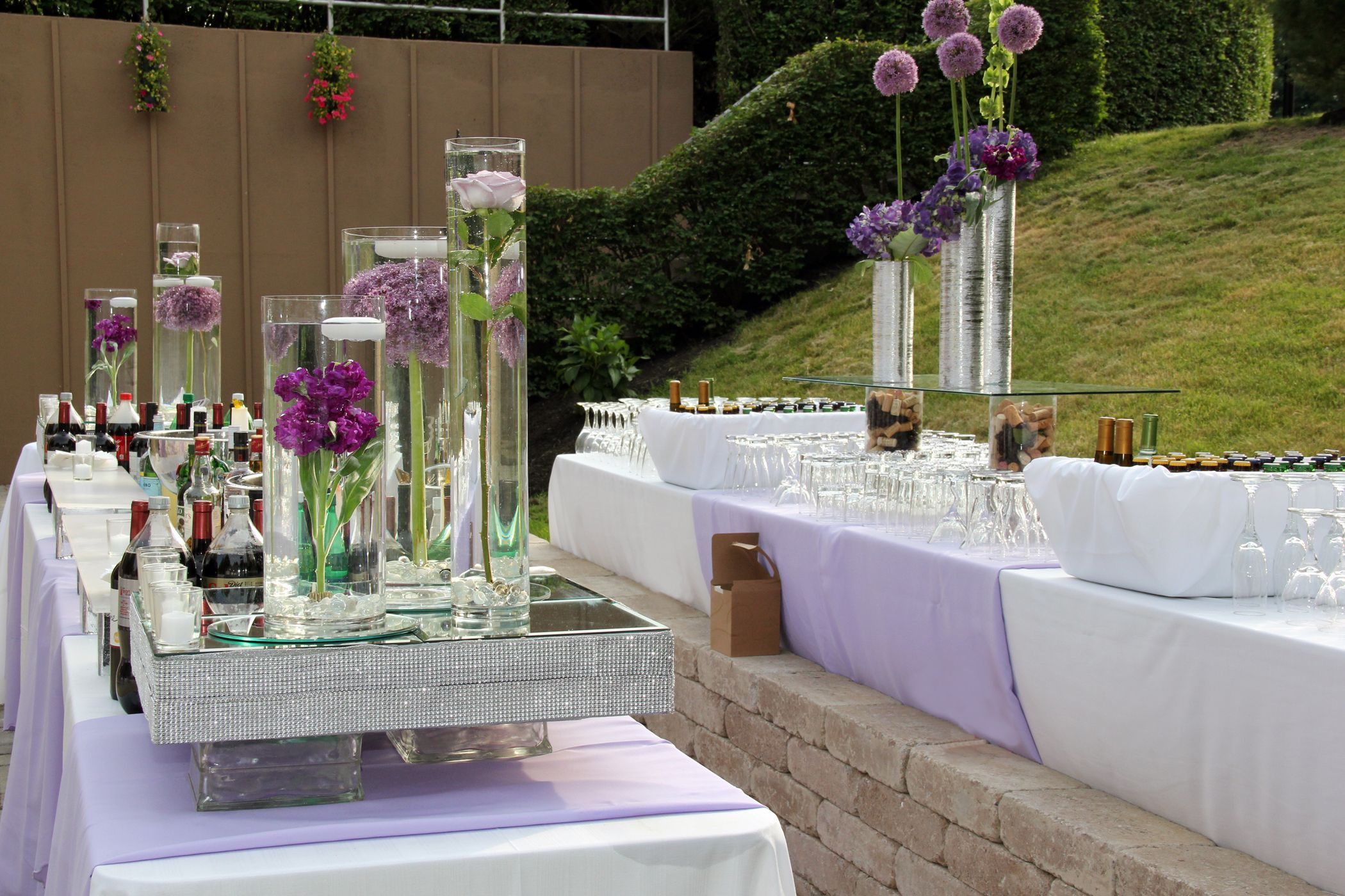 Summer bar set up for an outdoor garden wedding reception which includes style and design for Summer garden and bar