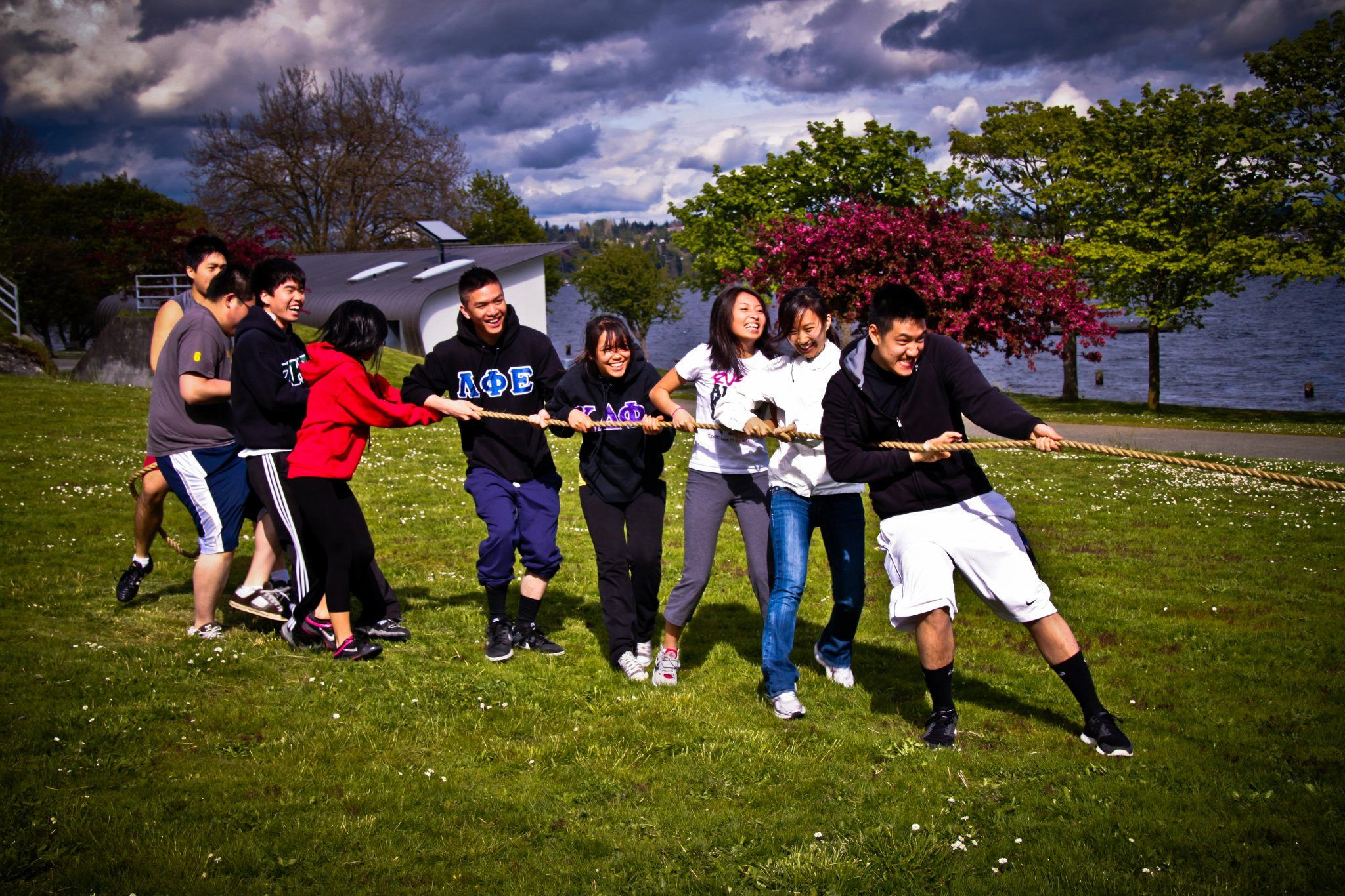 "Lambdas win a game tug-of-war at United Greek Council's ""Olympus"" mixer. They say that #might makes right! All it took was a little bicep love and elbow grease to go out and pull through in order to attain victory. The battle was epic, full of grunting and groaning, and the winning team brought the losers to their knees."