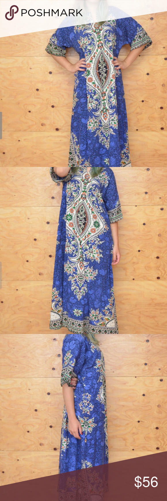 """Vintage 70's Blue & Black Thai Caftan, Maxi Length DESCRIPTION: Blue and black cotton Thai caftan dress. Dramatic look, great feel, short sleeves, long maxi length. Unique look and flare, great for that bohemian summer day at the beach.   Condition: EXCELLENT~ Previously worn, with only very slight wear; no flaws  ITEM MEASUREMENTS  Shoulder: 16"""" Bust: Open Waist: Open Hip: Open Length: 52"""" Sleeves: 12"""" Dresses Maxi"""