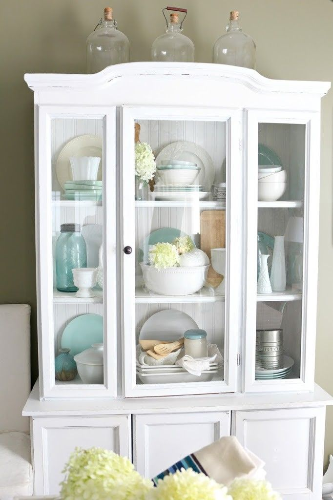 How to Decorate With Vintage Glass Bottles in 2019  Best of Pinterest  Dining room hutch