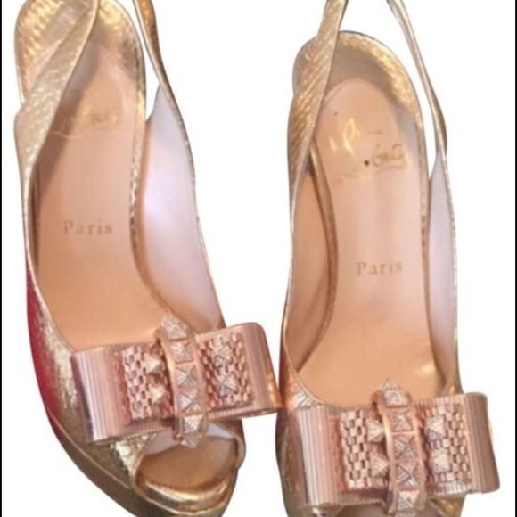 Louboutin Metal Nodo - very good condition Worn twice - two small marks (1 on each shoe) Christian Louboutin Shoes Platforms