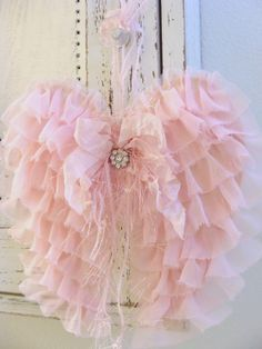Ruffled pink fabric wings