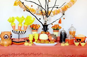 Trick or Treat Tree: With long, spindly branches reaching out every which way, we think this easy-to-make treat tree is the perfect centerpiece for your tablescape. Collect tree branches and twigs outside, then coat them in black spray paint. Once dry, group them in a sturdy yet decorative vase, letting the branches lay naturally.