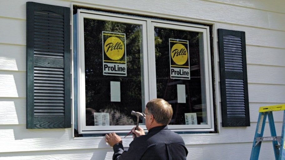 cost of new windows for home bay window man installing window how much does window replacement cost home improvements