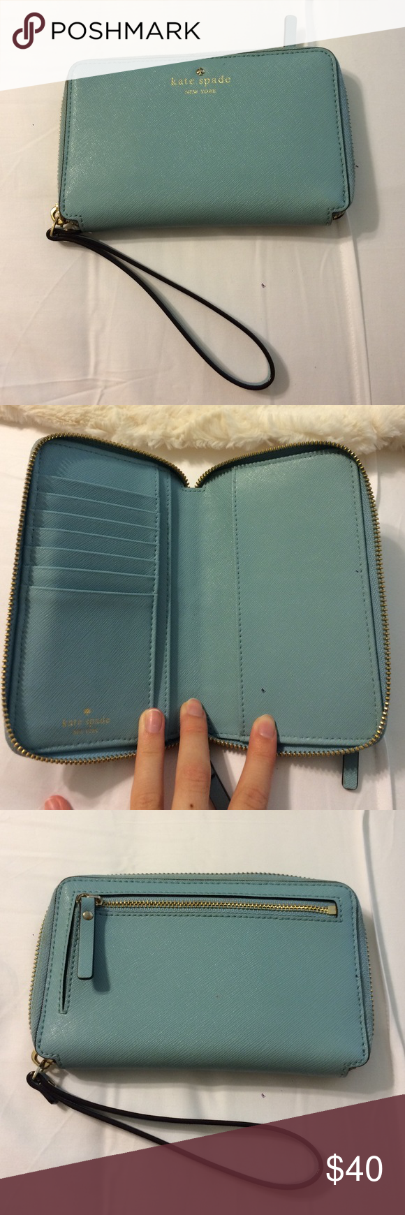 Kate Spade light blue wallet Late Spade light blue wallet with arm band. Lots of space. Has coin holder. Good condition. kate spade Bags Wallets
