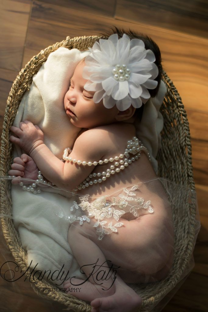 Using the mothers wedding veil, we draped it across the baby to create a beautiful and soft image of a new life joining a strong marriage to become a family. #newborn photography, #wedding veil #including you wedding veil into a newborn session,