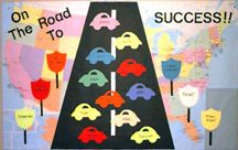 """On the Road to Success"" maps, highway signs, road, and car bulletin board"