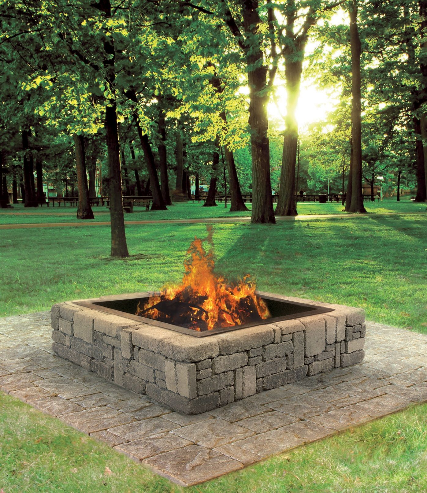 this rustic fire pit makes a great addition to your backyard cabin