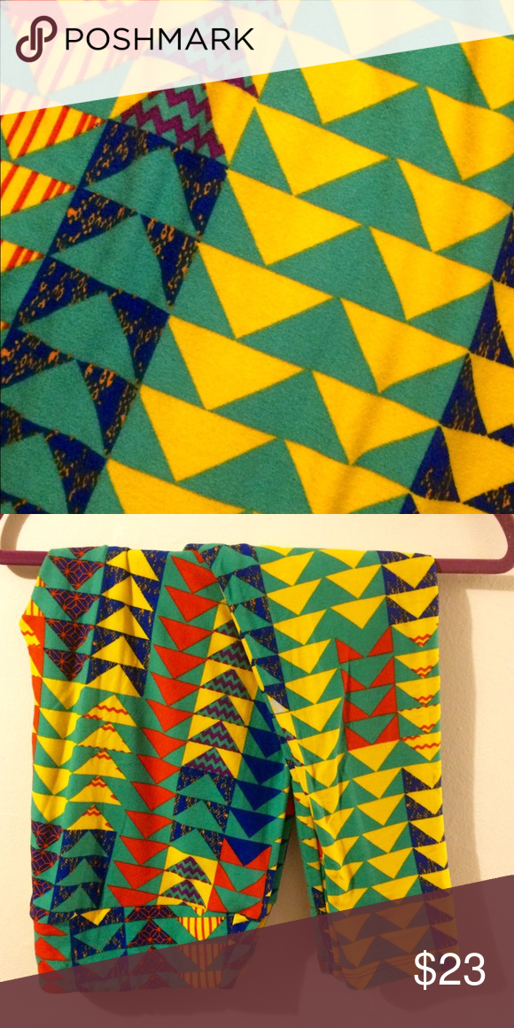 LuLaRoe Leggings TC LuLaRoe Leggings TC Thin and Curvy fits 12-24. Orange, green, yellow and blue geometric pattern. Worn 1x, like new condition and buttery soft. Washed to LLR standards never put in dryer. LuLaRoe Pants Leggings