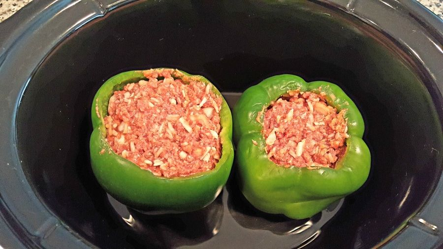 Two Green Peppers Stuffed With Ground Beef Mixture Inside A Crockpot Slow Cooker Stuffed Peppers Stuffed Green Peppers Stuffed Peppers