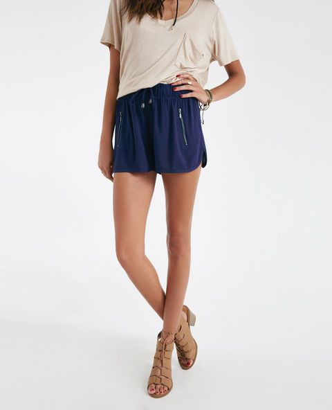 """Stylish and lightweight, these comfy shorts features a soft challis body, zipper pockets, a drawstring front with metal details, a cuffed hem, and an elastic waistband for a stretchy, snug fit. Model wears a size small. Mid-Rise / Drawstring Closure / 3"""" Inseam / Rayon /  Machine Wash / Imported"""