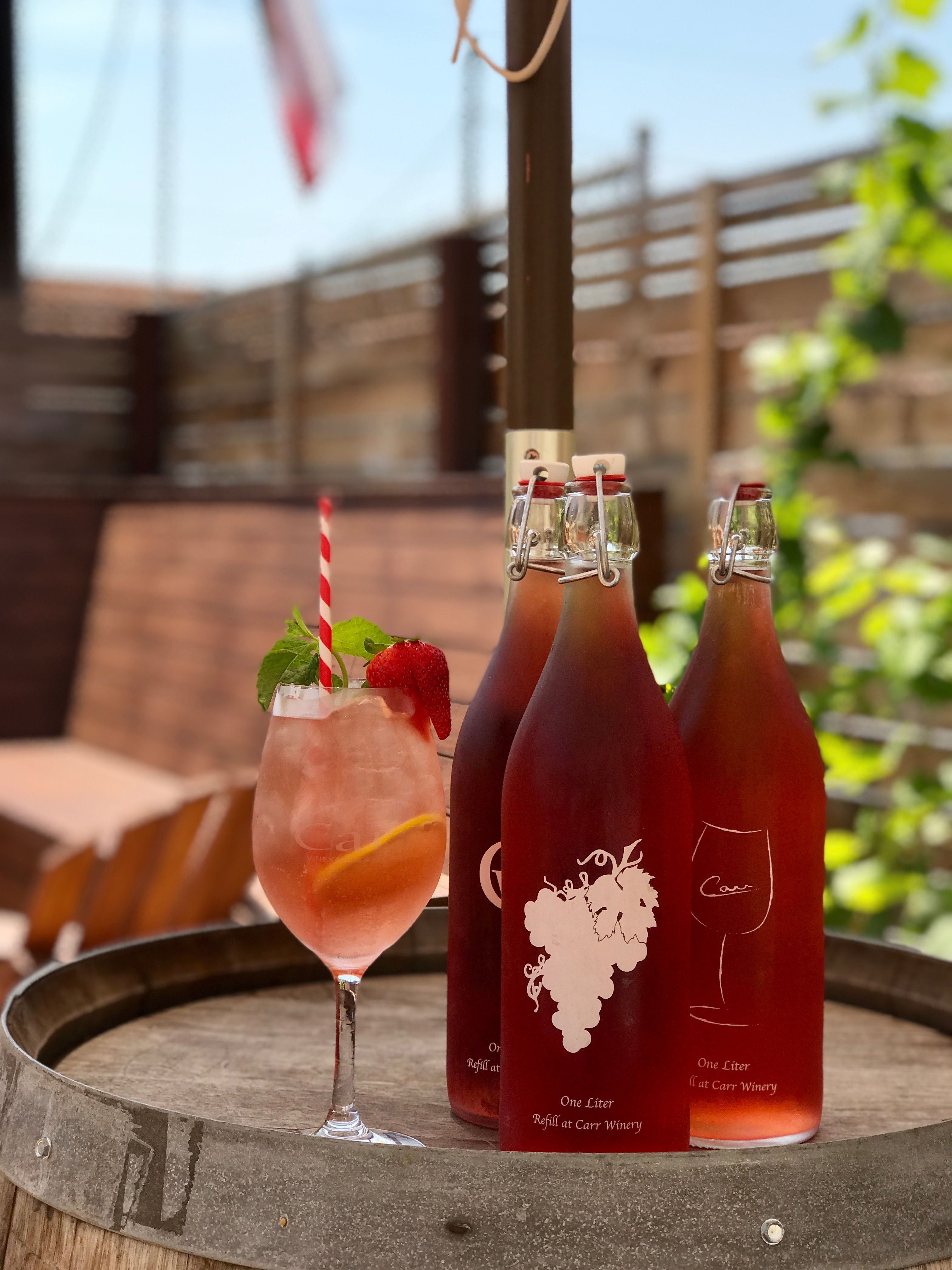 Patio Beats With Rose Spritzers Wine Bottle Barrel Room Winery