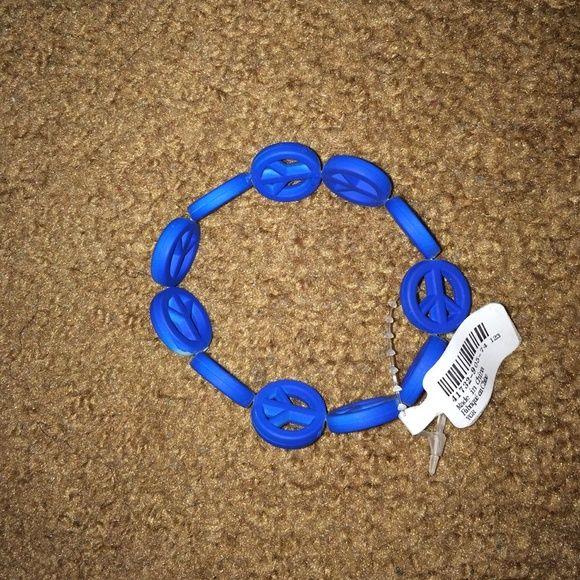 Blue Peace Sign Bracelet Cute blue peace sign slide on bracelet. Never worn!!! Brand new!! Jewelry Bracelets