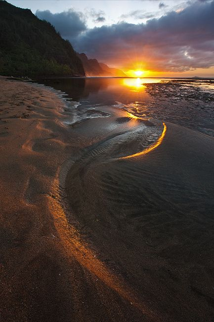 New Years Eve. Conditions were perfect to hopefully capture an unique photograph of Ke'e Beach. When I saw this curve in the sand and the gap below the clouds I knew I had my shot. Great way to end the year!