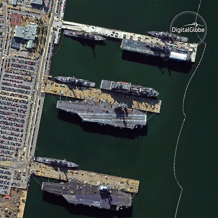 Aircraft carriers and ships docked at Naval
