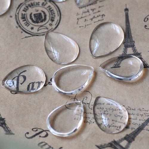 Leslie's bridal:  20pcs 10x14mm Glass Transparent Clear Teardrop Cabochon Cameo Cover. $2.99, via Etsy.