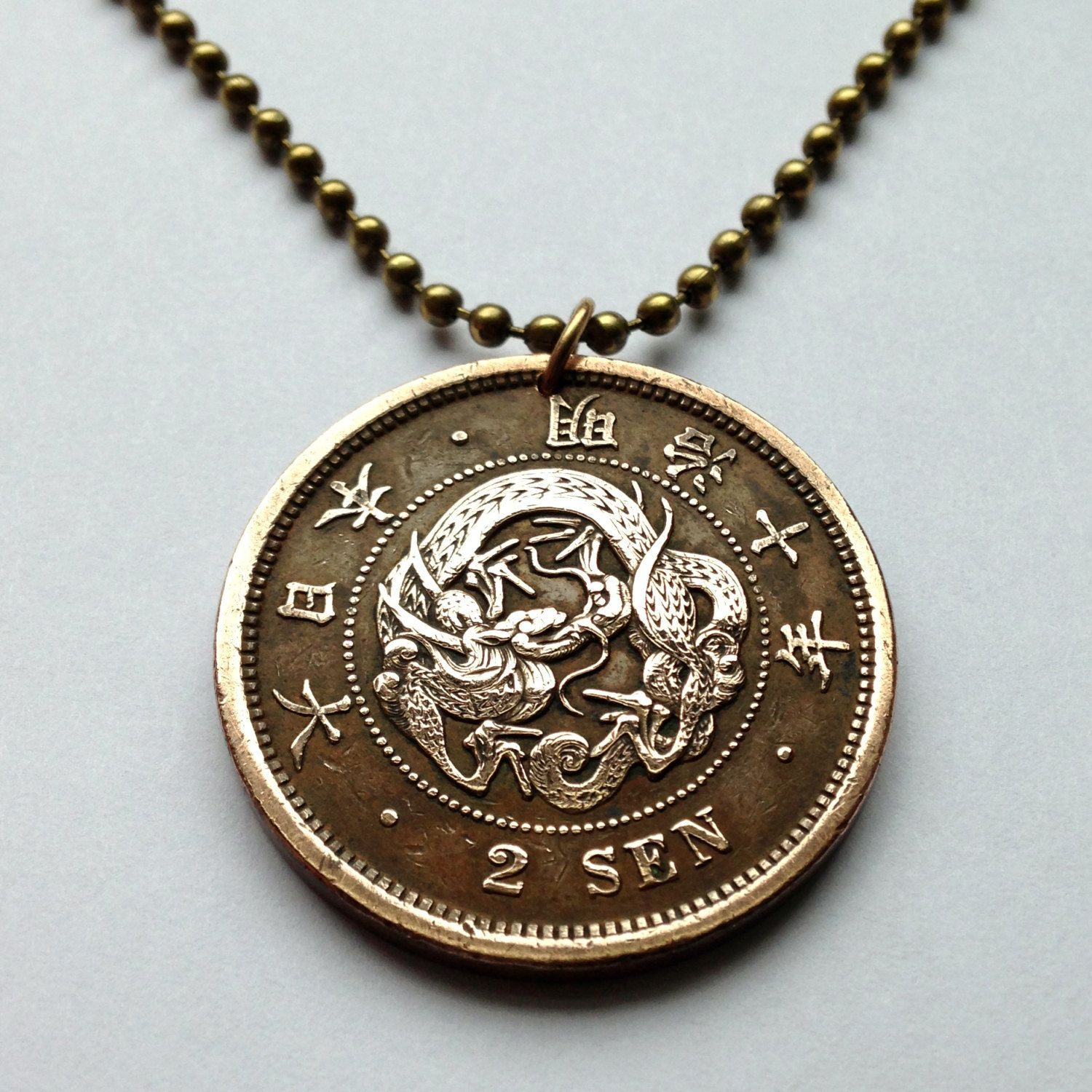 1877 japan 2 sen coin pendant ryu seiryu japanese dragon mythology 1922 japan 5 sen coin pendant charm necklace jewelry blossom flora symmetrical flower design scales leaves mozeypictures Images