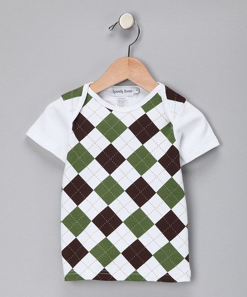 This fun cotton tee adds argyle style to any outfit. Charming and comfortable, it's sure to become a fast favorite.Note:Size 2 has a lap neck; sizes 4 and 6 have a crew neck.100% cottonMachine wash; tumble dryImported<...