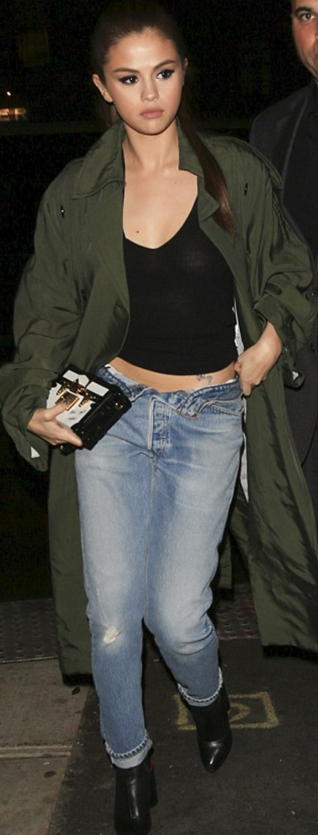 Who made  Selena Gomez's black boots, blue jeans, green coat, and box clutch?