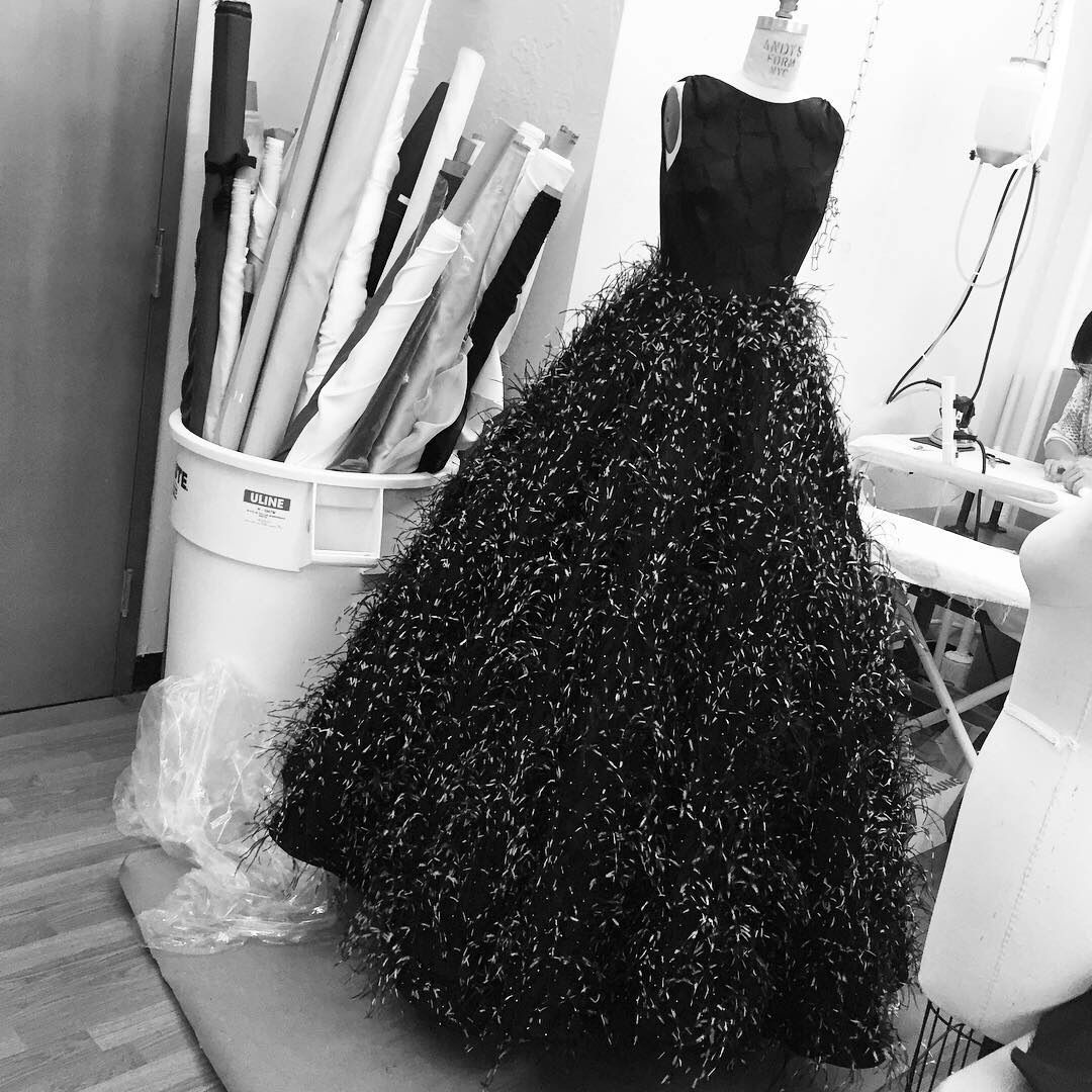 Beaded feather gown being worked on in the studio today.