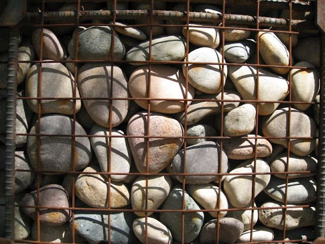 Short gabion privacy wall using river rock check for River rock wall