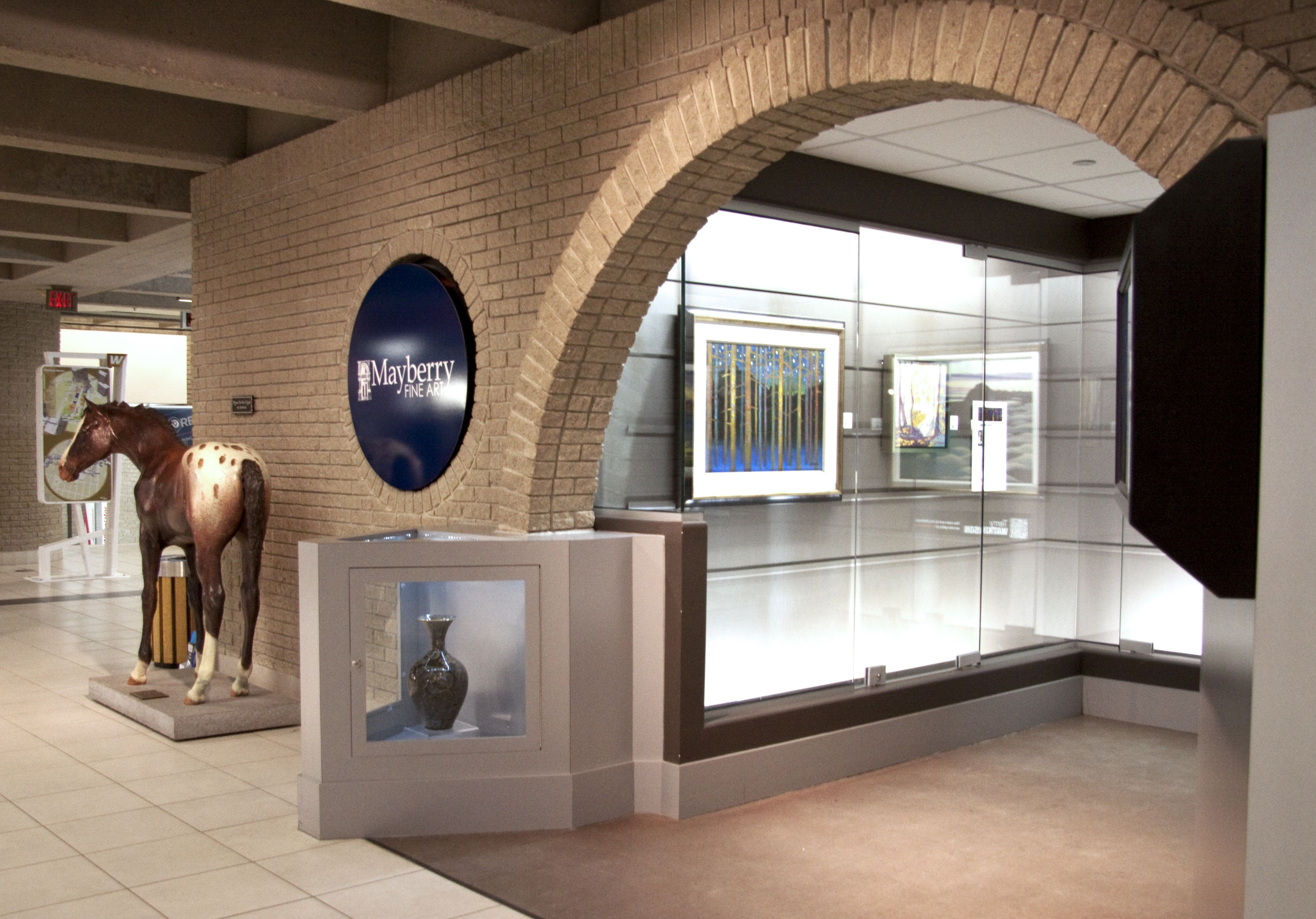 Mayberry Fine Art has a satellite space in Winnipeg Square Mall, located near Portage and Main. It features a display that changes monthly and is open during mall hours.