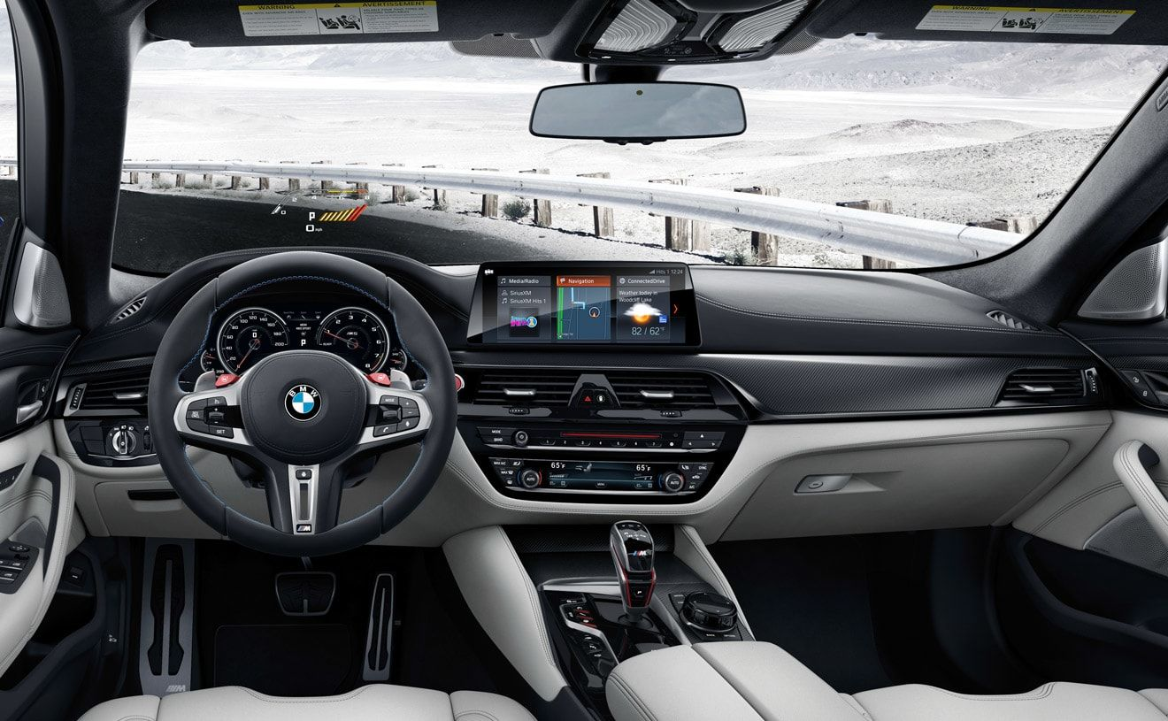 Interior Of The Bmw M5 In Silverstone Full Merino Leather Showing Idrive 6 0 And M Specific Head Up Display Bmw M5 Bmw Bmw Motorcycles