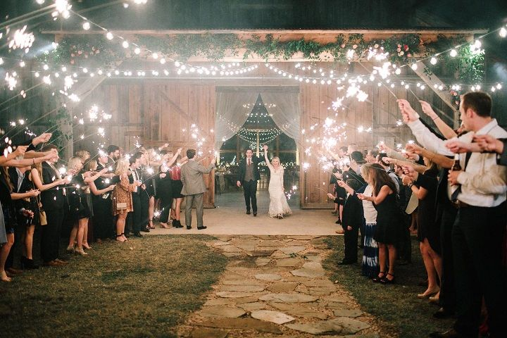 Romantic wedding reception decorated with fairy lights #weddinglights #barnwedding