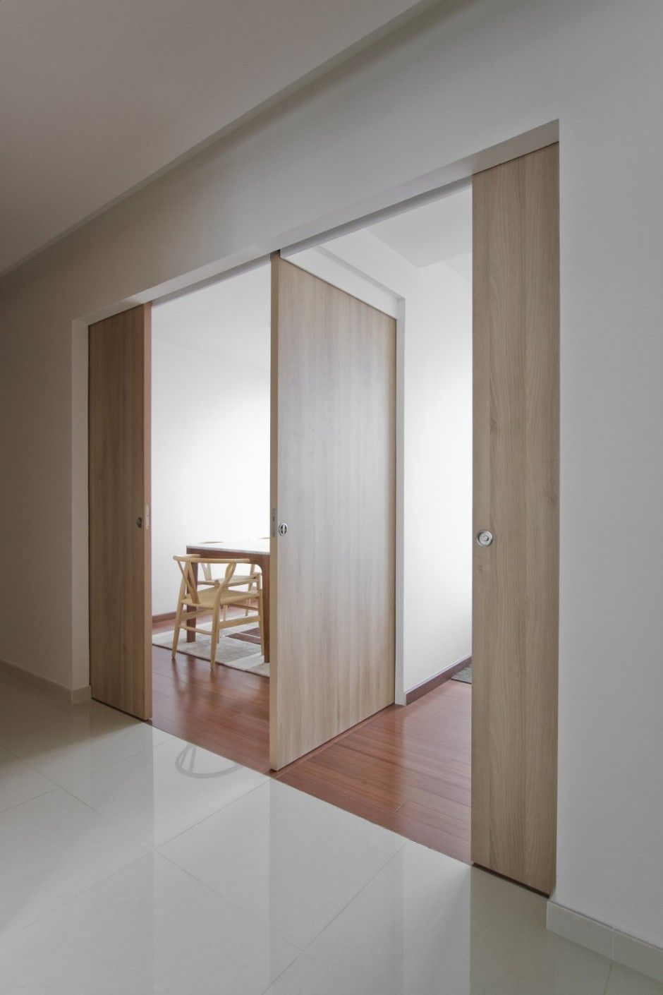 Three pocket doors meet to make 2 rooms that are other for Pocket door ideas