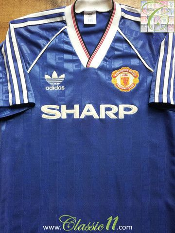 be055d182 Relive Manchester United s 1988 1989 season with this vintage Adidas 3rd  kit football shirt.