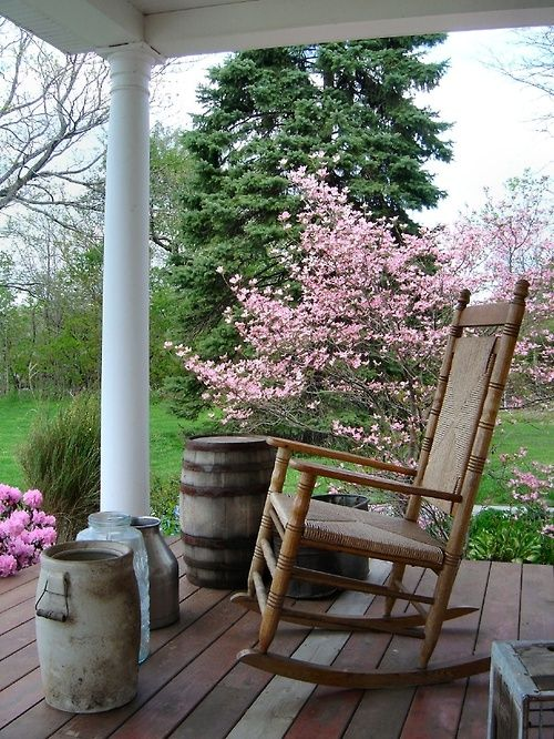 Country porch surrounded by awakening shrubs | April-Easter-Spring