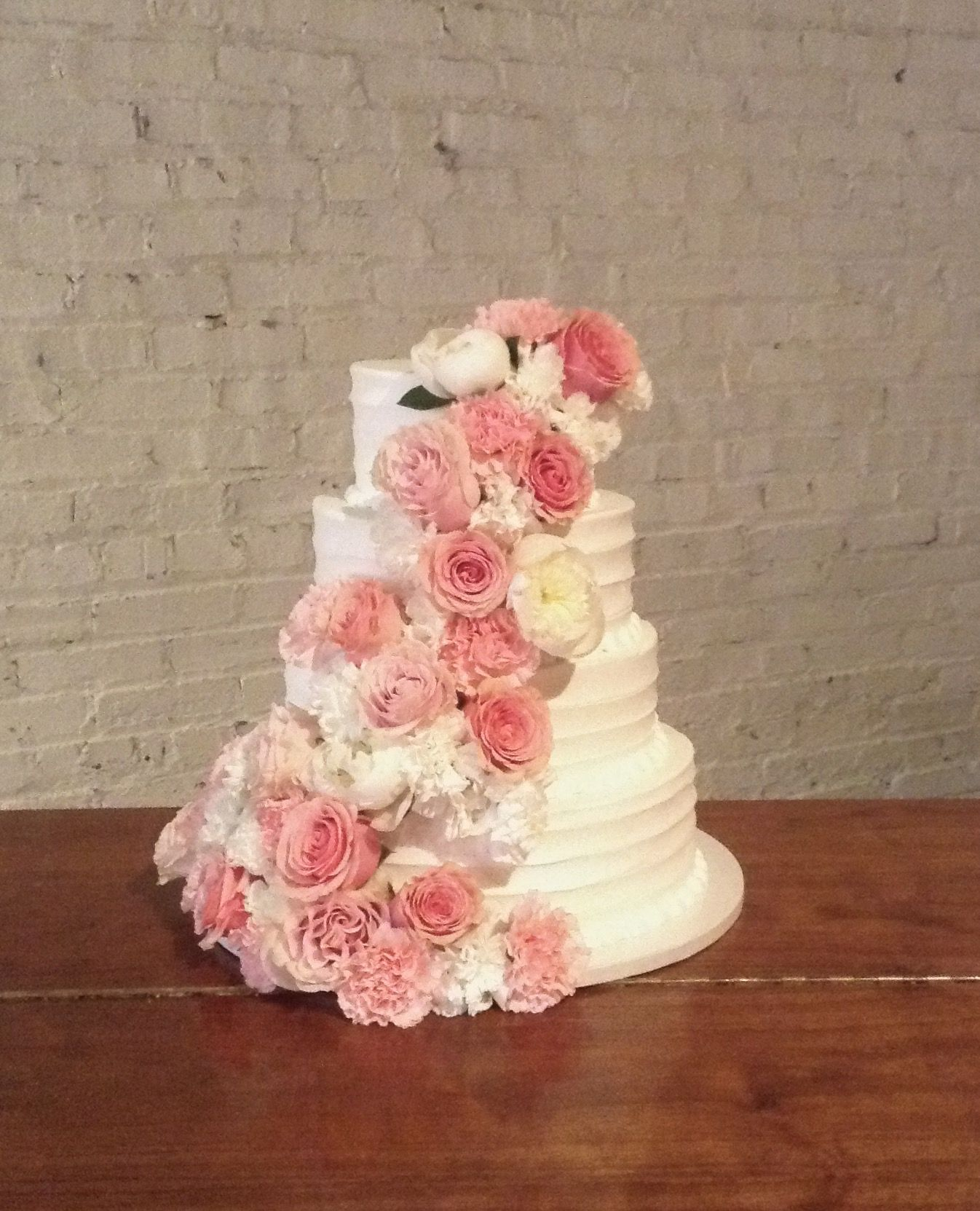 Wedding Cake By Amy With A Cascade Of Fresh Flowers By