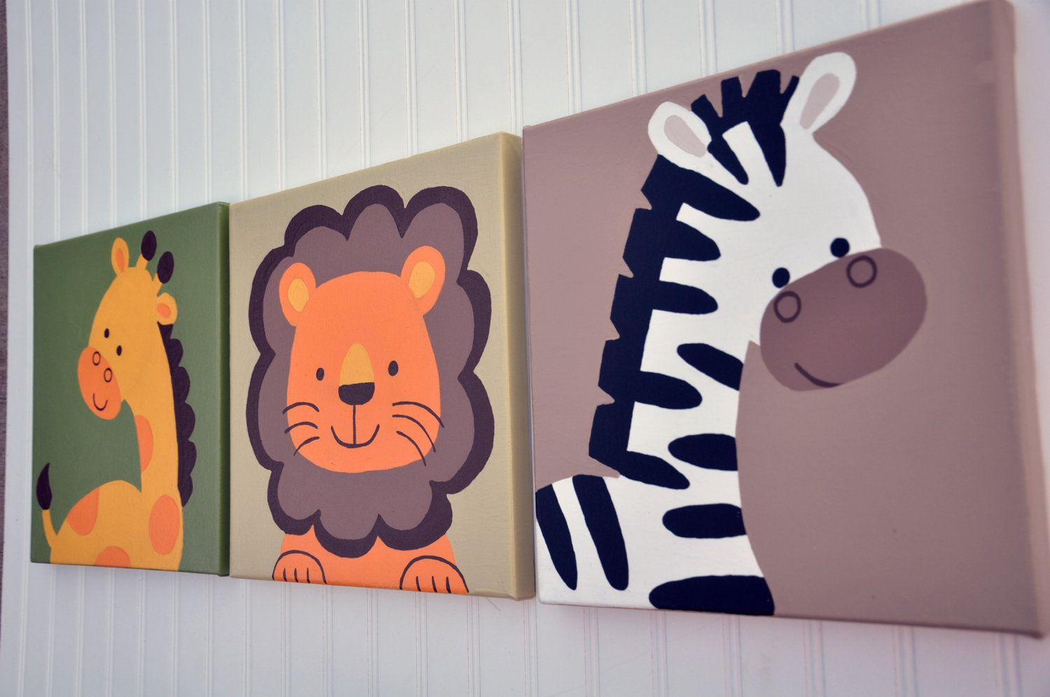 3 Piece Original Painting Canvas Animal Nursery Set- Lions, Giraffes, and Zebras OH MY. $75.00, via Etsy.