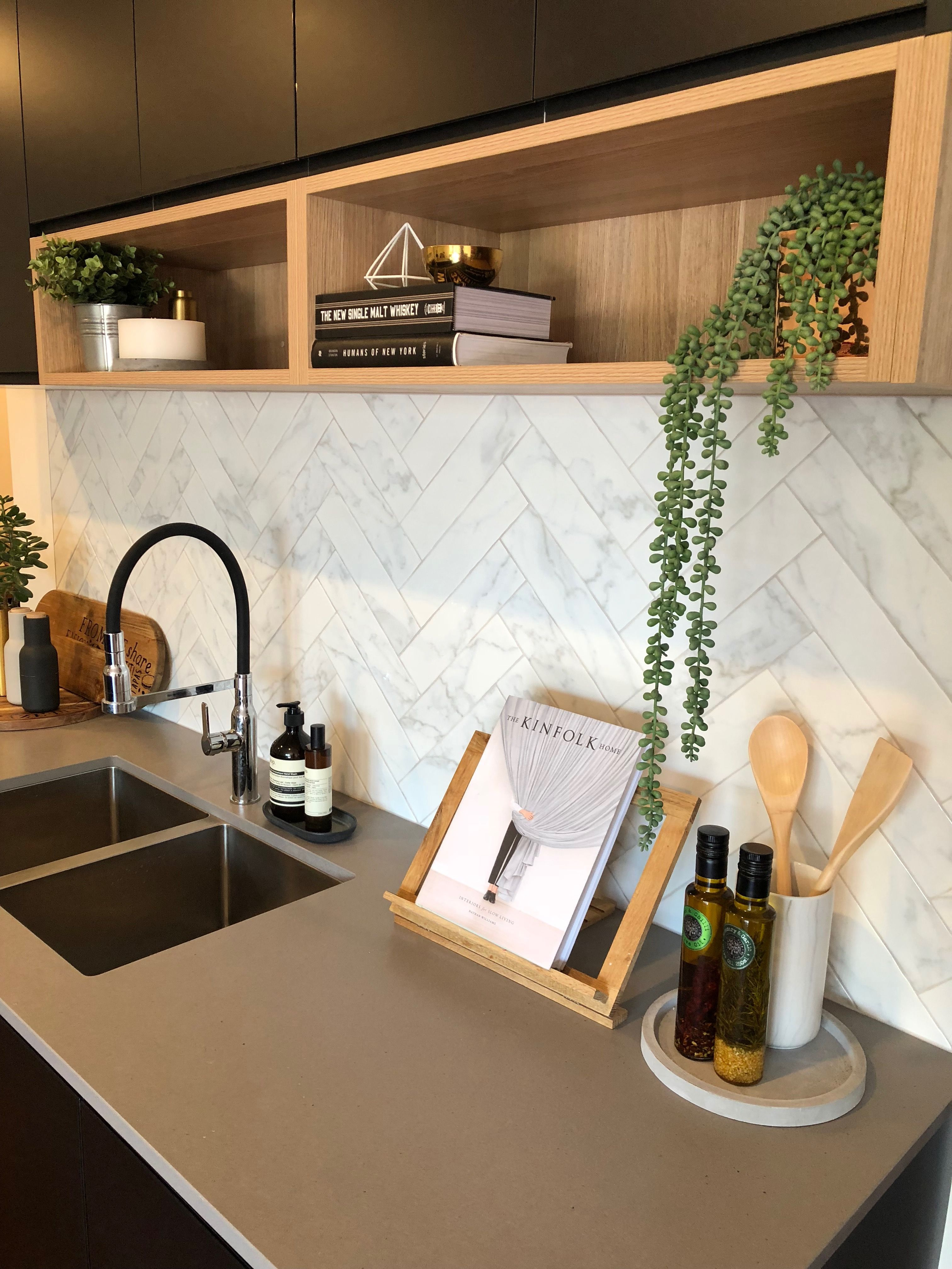 Matt black kitchen with timber shelf detailing, Caesarstone sleek ...
