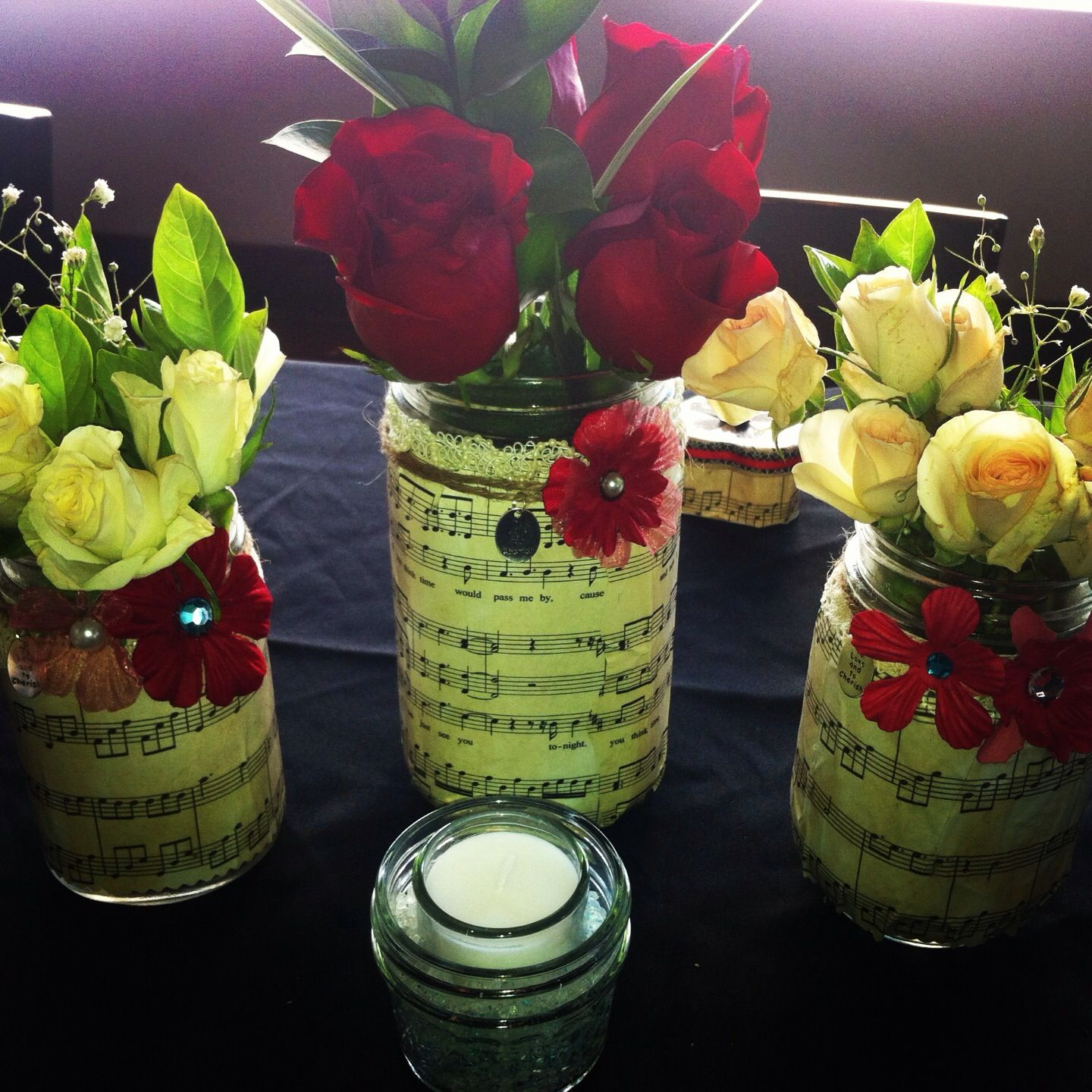 I made mason jars with vintage music sheets lace twine and