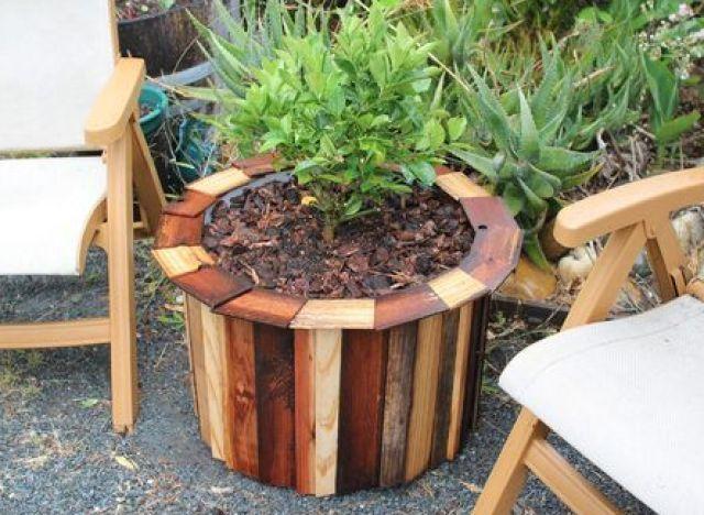 Wooden Garden Planters Ideas pretty front porch diy large cedar planter boxes Turn A Plastic Trash Barrel Into A Standout Planter Easy Diy Projectsgarden
