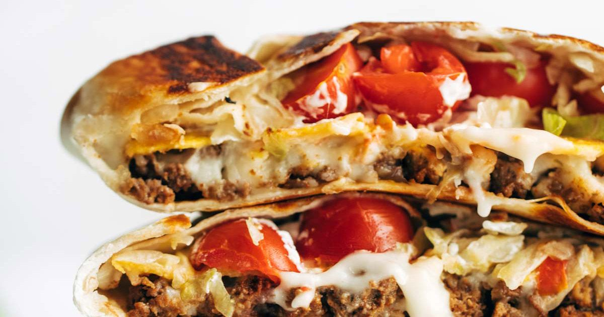 Crunchwrap Supreme! Just like Taco Bell. Layers of taco meat, queso, tostada, lettuce, tomato, salsa, hot sauce, and sour cream.