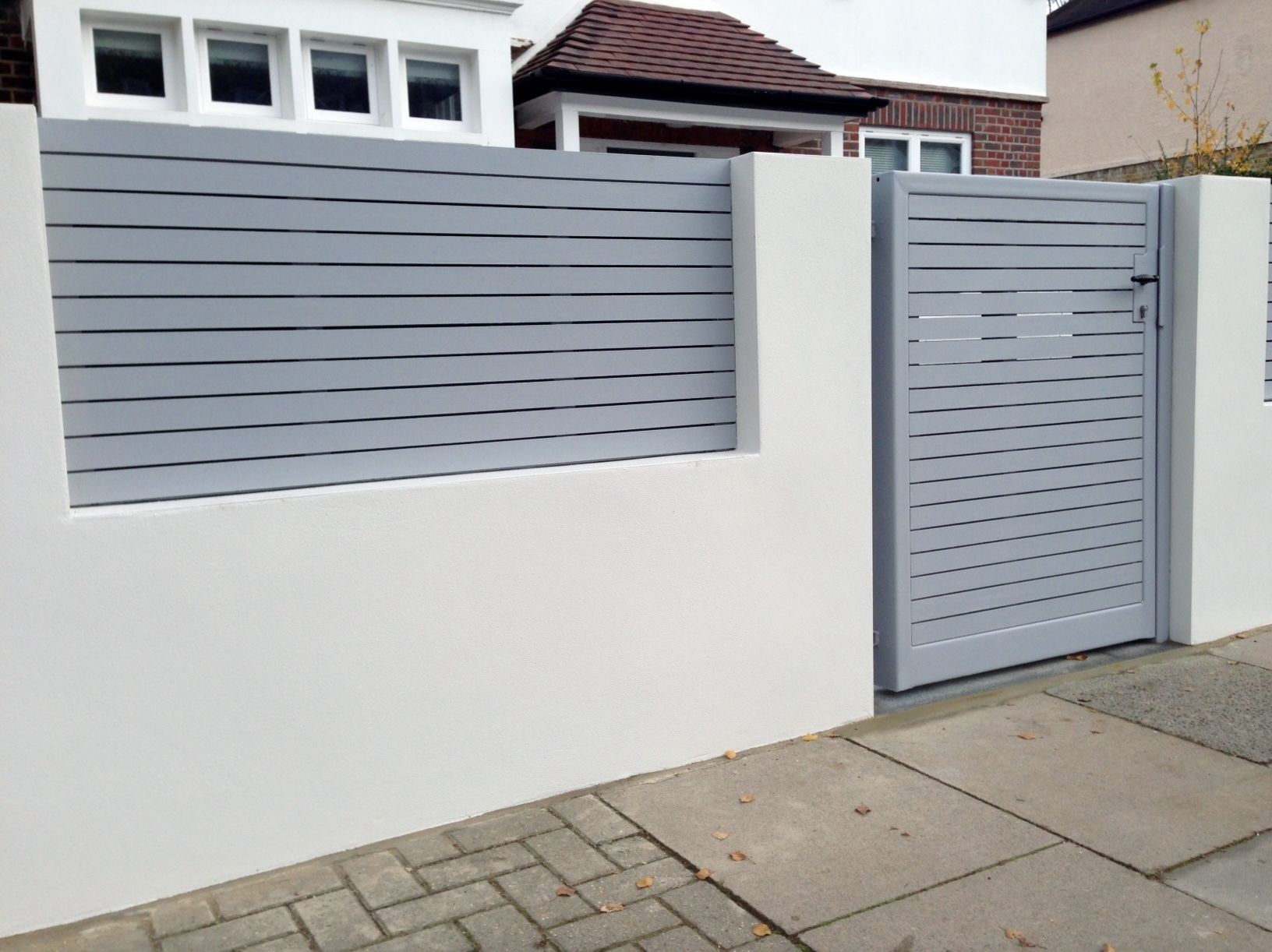 Front boundary wall screen automated electronic gate installation grey wooden fence bike store modern garden design