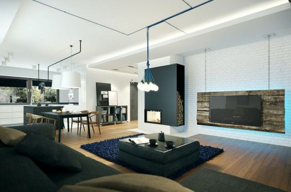 The living area and kitchen are left open to one another in true modern fashion  large sectional sofa is practical addition while hang also