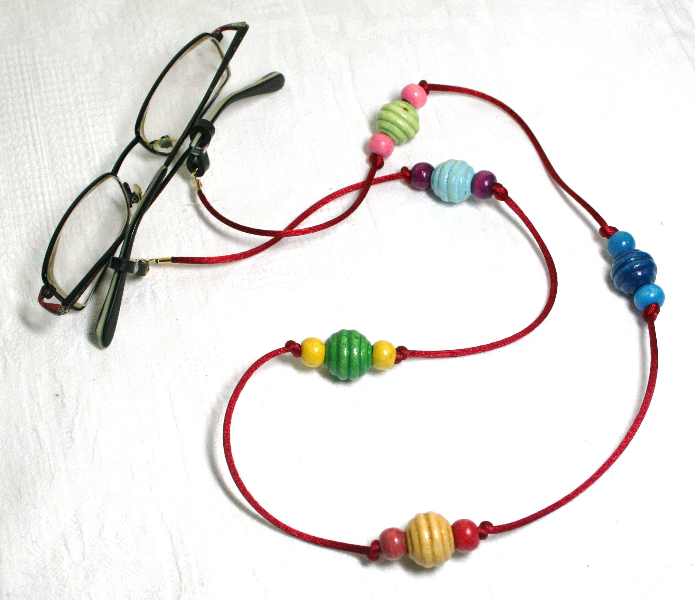 Red satin cord with wooden beads. www.facebook.com/Supposejewellery ...