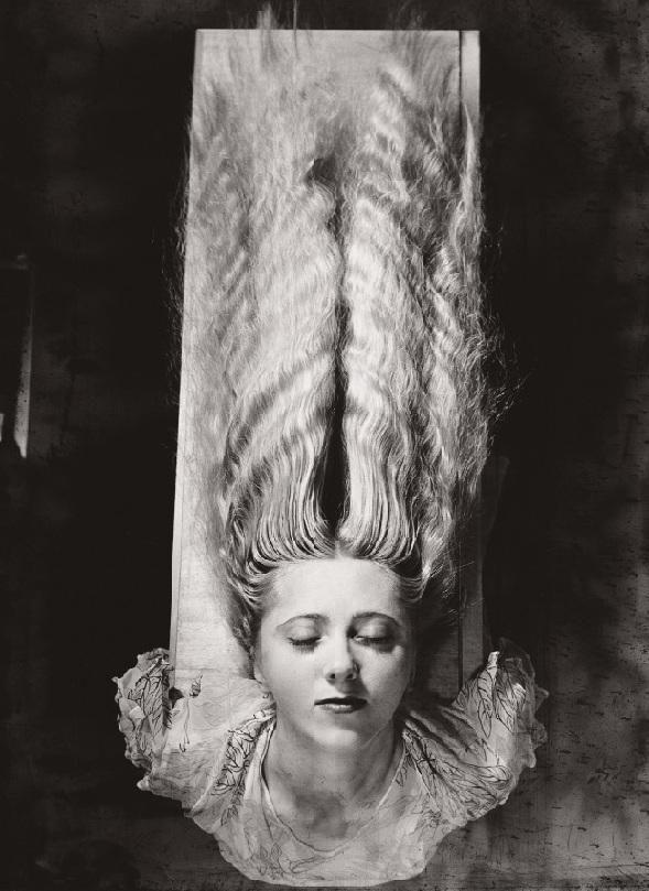 Femme aux cheveux longs man ray
