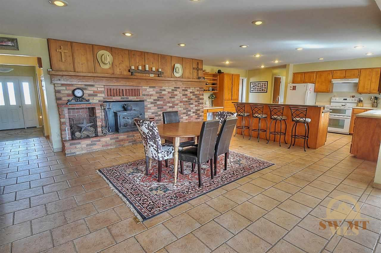 Who doesn't want a classic brick fireplace in their kitchen? #bozemanrealestate