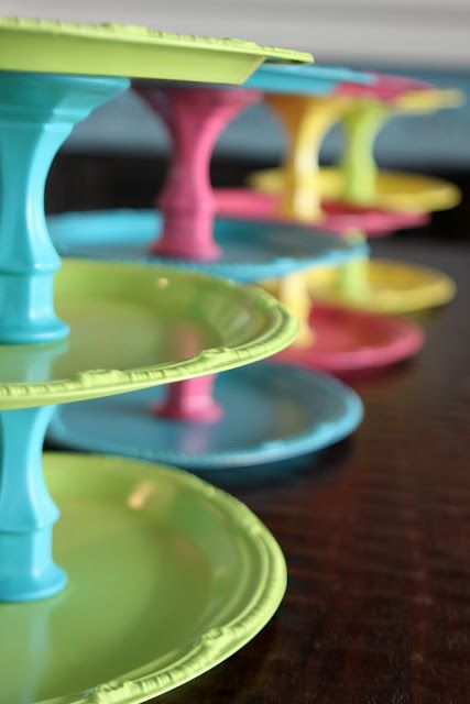 use trays and candlesticks from the Dollar Store to make tiered displays. retail displays