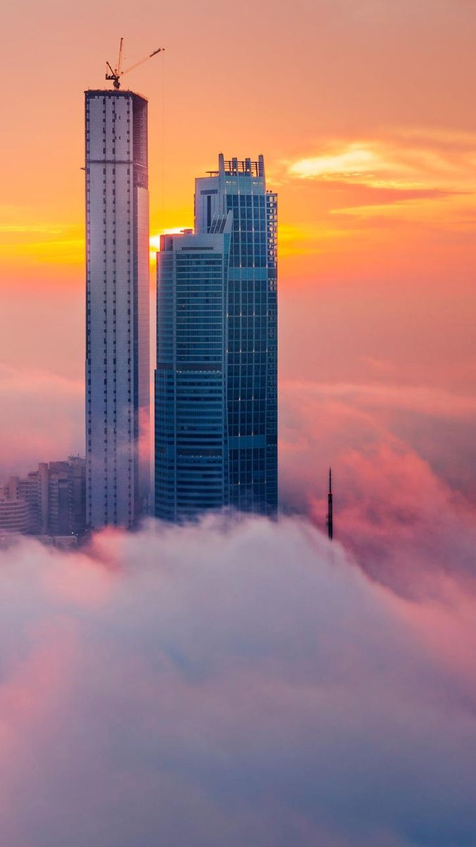 Cloudy Towers Abudhabi Iphone Wallpaper Iphone Wallpaper Wallpaper What A Beautiful World